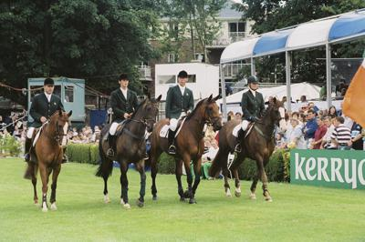 RDS Dublin Horse Show 2000, Irish Team entering arena for Aga Khan Cup, Peter Charles, Billy Twomey, Dermott Lennon and Jessica Kurten.
